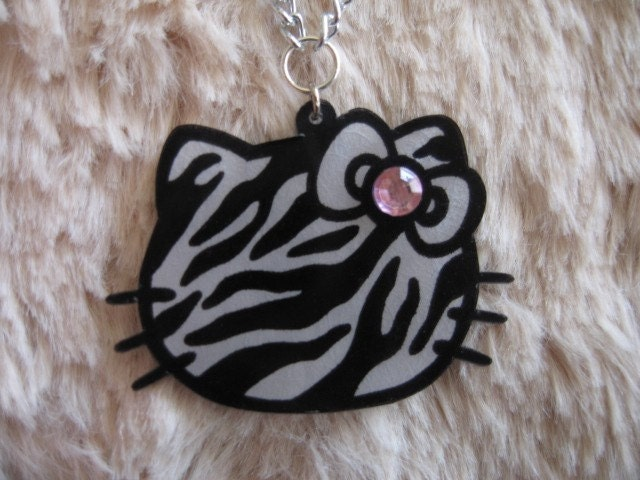 Zebra print hello kitty necklace w/ pink rhinestone. From bratfactory