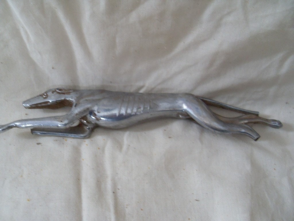 Vintage Greyhound Hood Ornament. From PrimitiveWhiteHouse