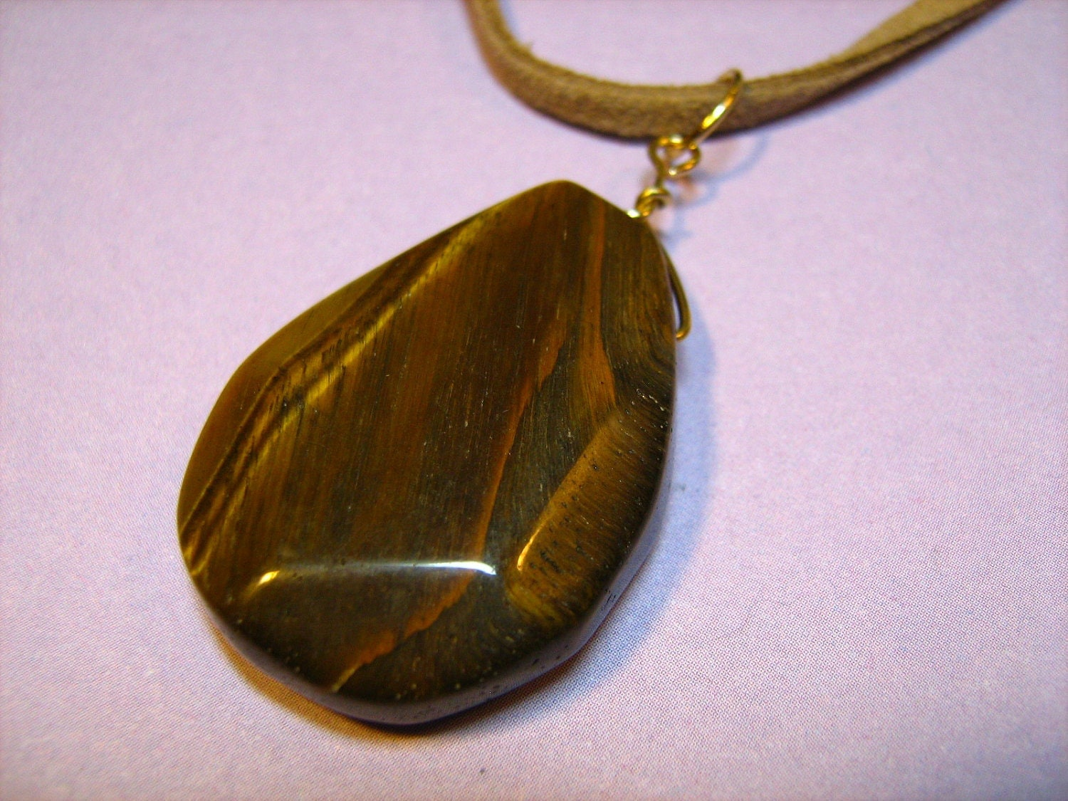Necklace: Tiger's Eye Stone Pendant with Goldtone Findings and a Tan Suede Cord Necklace for Women