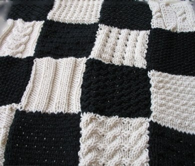 Small black and white hand-knitted blanket in many patterns for a favorite