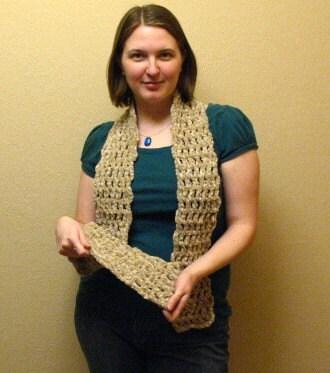 Champagne-colored crochet scarf