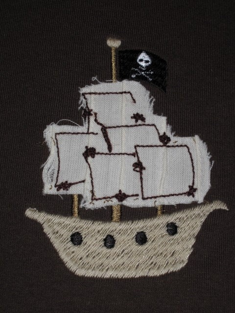 The pirate ship has appliqued sails