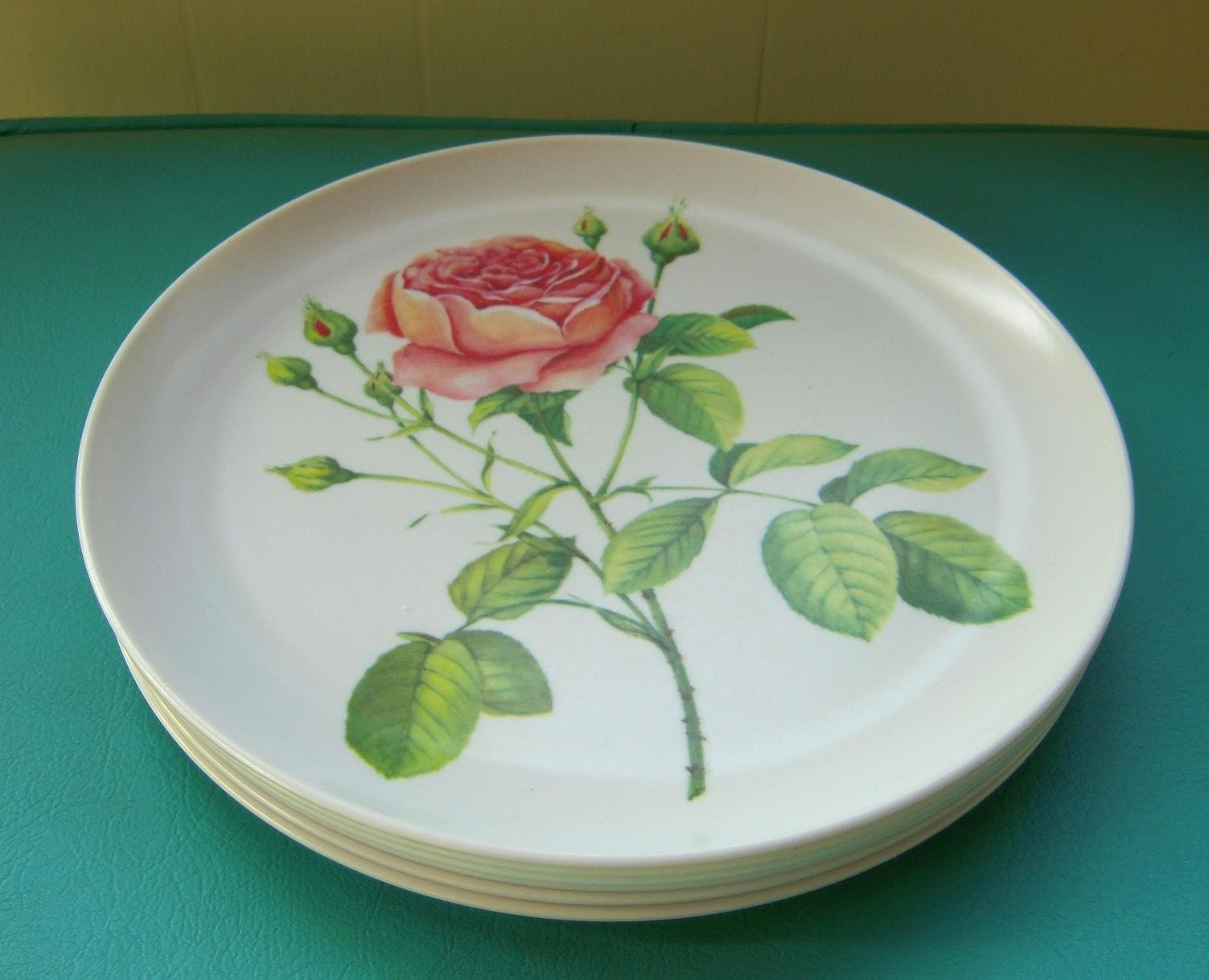 Heres a fantastic set of vintage melmac! The pink rose design is a stunner and would right fit into your vintage or shabby chic decor!