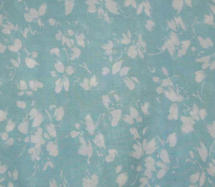 flower backgrounds for tumblr. It's a light turquoise blue in the background, with a floral white design.