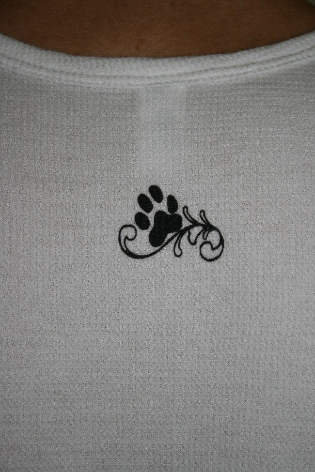 like the boots have cute cat paw prints on our stylized paw print tattoo